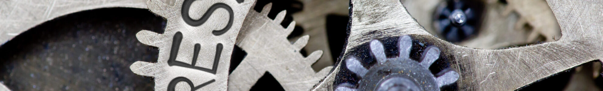 Macro photo of tooth wheel mechanism with RESPONSIBILITY concept letters
